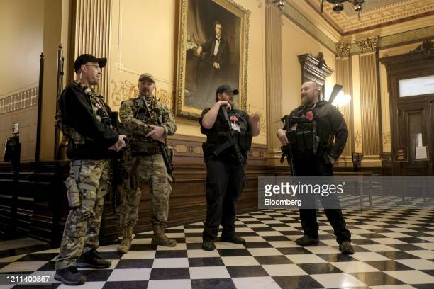 Armed protesters gather at the Michigan Capitol Building in Lansing, Michigan, U.S., on Thursday, April 30, 2020. Protesters demanded that the state...