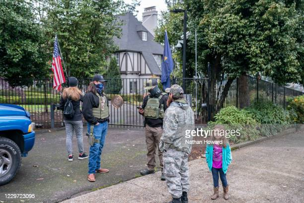 Armed protesters gather in front of Gov. Kate Brown's residence, Mahonia Hall, on November 21, 2020 in Salem, Oregon. Protesters angered by lockdown...