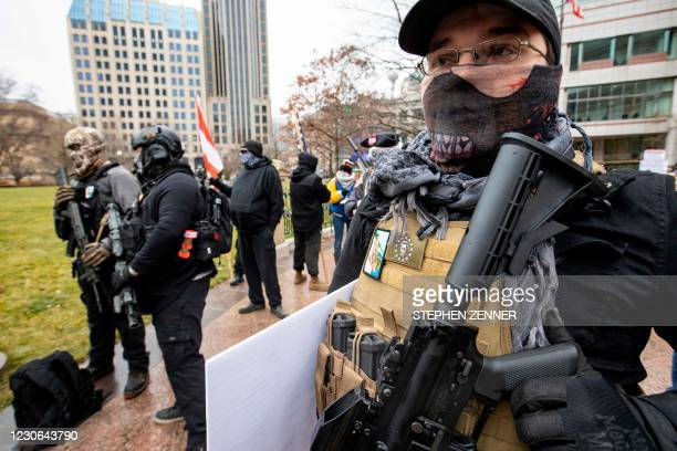 Armed protesters gather in front of the Ohio Statehouse in Columbus, Ohio, January 17, 2021 during a nationwide protest called by anti-government and...