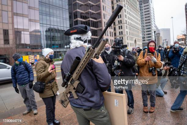 Armed protestors as seen during an armed protest at the Ohio Statehouse ahead of the inauguration of President-elect Joe Biden in the wake of the...