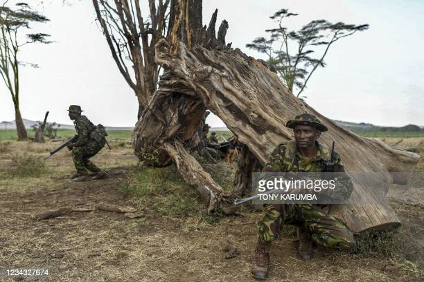 Armed rangers and their tracker dogs patrol in a section of the Lewa Wildlife Conservancy in Meru, on July 30, 2021. - Rangers play a central and...