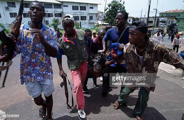 Armed rebel fighters of the National Patriotic Front of Liberia