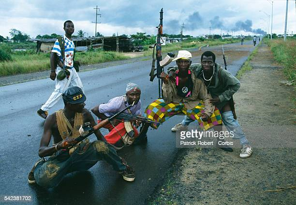 Armed rebel fighters of the NPFL pose on a road in Monrovia during the Liberian Civil War In 1989 Charles Taylor leader of the NPFL launched a revolt...