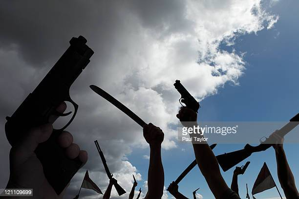 armed rebellion with approaching storm - protestor stock pictures, royalty-free photos & images