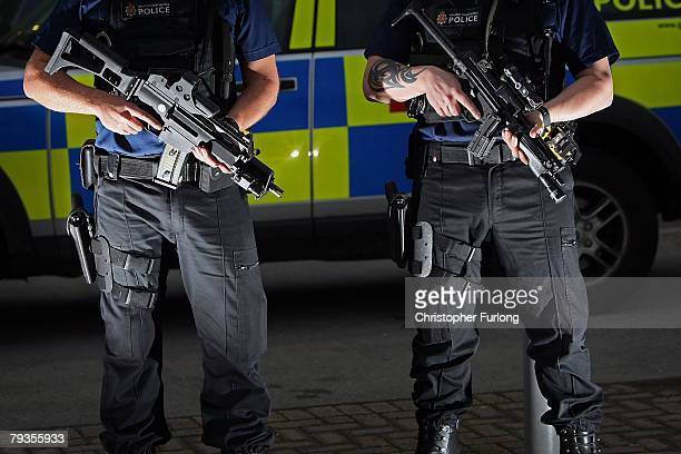 Armed response officers from Greater Manchester Police pose with Heckler and Koch G36 assualt rifles during the first ever Vanguard Conference a...