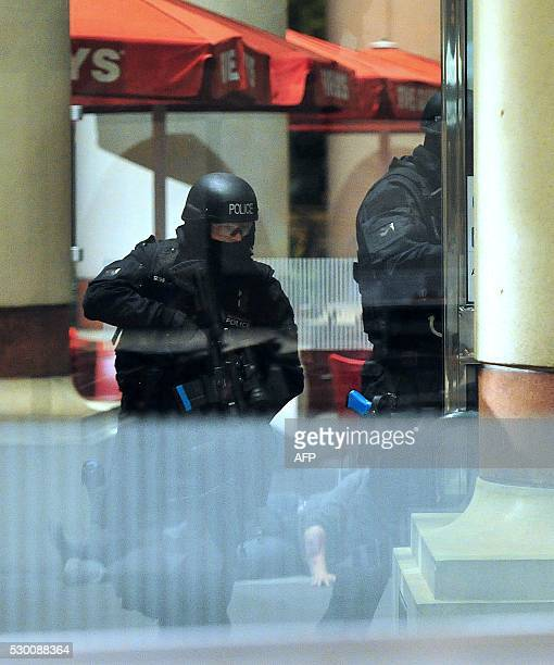 Armed response units arrive during a simulation of an attack by a suicide bomber inside a shopping centre in Manchester north west England on May 10...