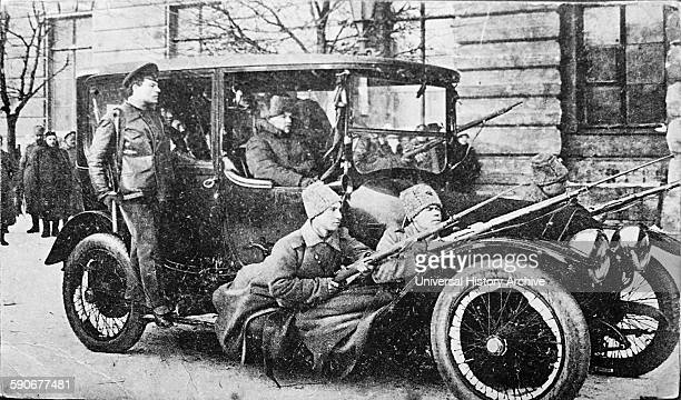 Armed revolutionary guards in a vehicle in Petrograd Russia during the Russian Revolution