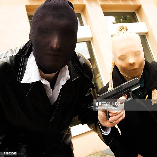 Armed robbers posing for a photo wearing masks