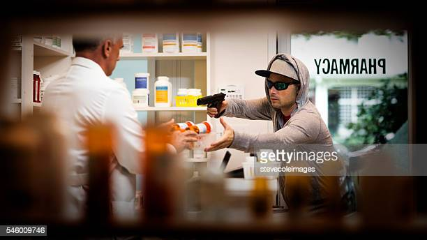 armed robbery - thief stock pictures, royalty-free photos & images