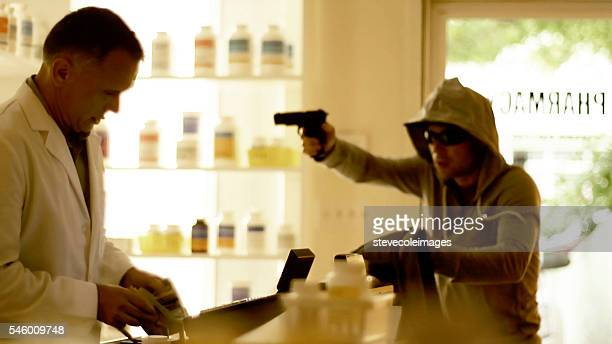 armed robbery - armed robbery stock photos and pictures