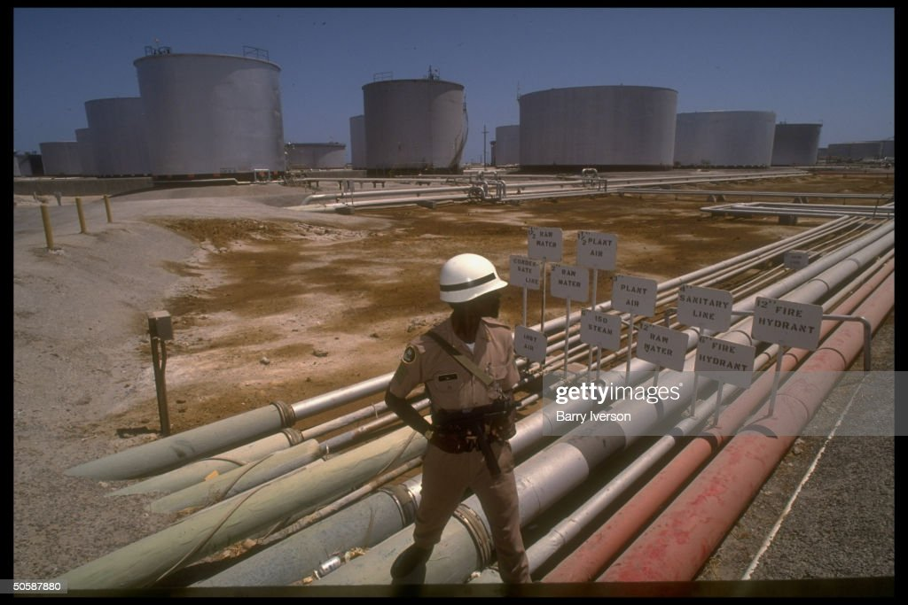 Armed Security Guard (on Gulf Crisis Alert) Poised By Pipelines U0026 Storage  Tanks At