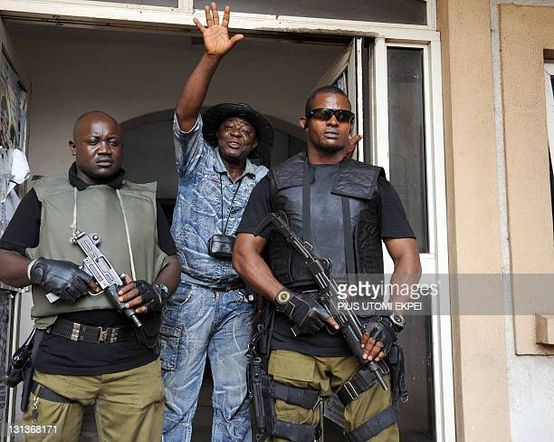 Armed security men barricade the main gate leading to the courtroom during the hearing of the case involving leading Nigerian comic actor Babatunde...