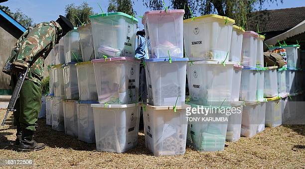 Armed security officers guard ballot boxes on March 5 2013 that have yet to be tallied at a tallying centre in Kakamega in the country's western...