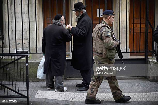 Armed security patrol outside a Jewish School in the Jewish quarter of the Marais district on January 12 2015 in Paris France Mr Cazeneuve visited...
