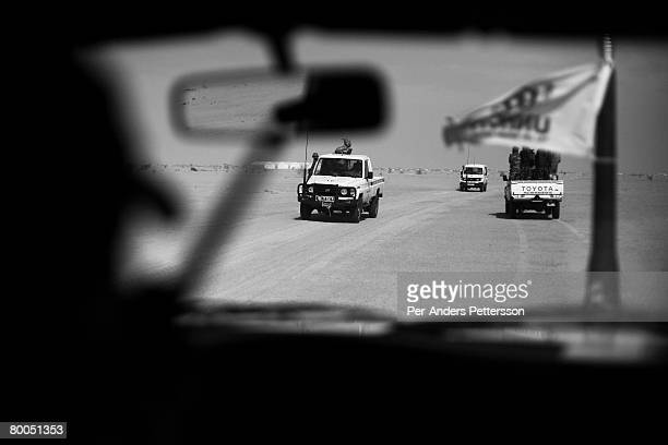 Armed security patrols escort aid worker vehicles outside the Oure Cassoni refugee camp on July 26, 2007 about 23 kilometers outside Bahai, Chad. Aid...