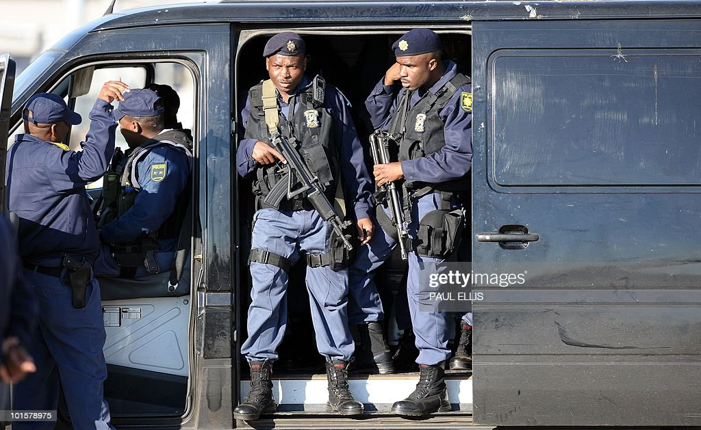 Armed security prepare to surround the plane carrying England's national football team as it arrives at Johannesburg Airport in South Africa for the 2010 Football World Cup Finals on June 03, 2010. The team will transfer to their hotel and training base at the Bafokeng Sports Campus near Rustenburg, ahead of their opening game against USA on June 12.
