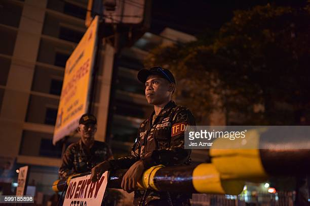 Armed soldiers at a checkpoint on September 4, 2016 in Davao City, Philippines. The Philippine government blamed the Abu Sayyaf militant group for a...