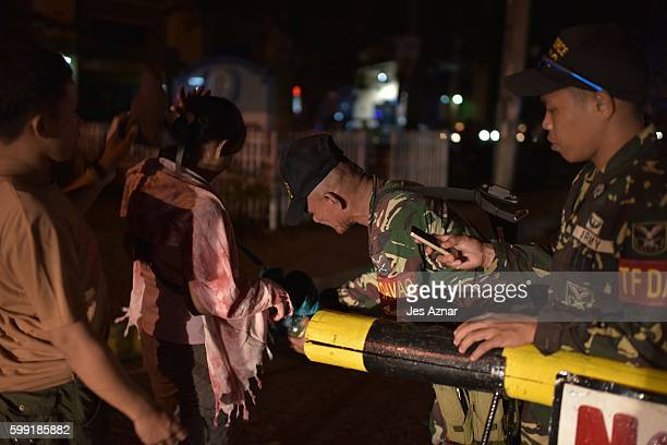 Armed soldiers conduct spot inspections on the streets of Davao City, September 4, 2016. The Philippine government blamed the Abu Sayyaf militant...