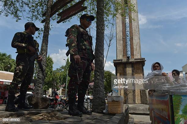Armed soldiers guard a public park, on September 4, 2016 in Davao City, Philippines. The Philippine government blamed the Abu Sayyaf militant group...