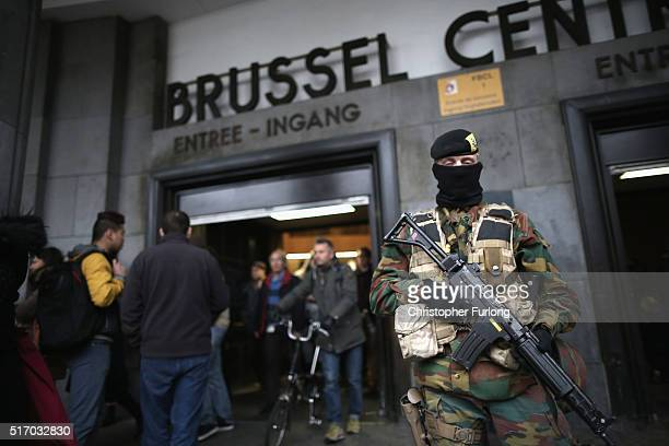 Armed soldiers guard the entrance to Brussels Central Station after yesterday's terrorist attacks on March 23 2016 in Brussels Belgium Belgium is...