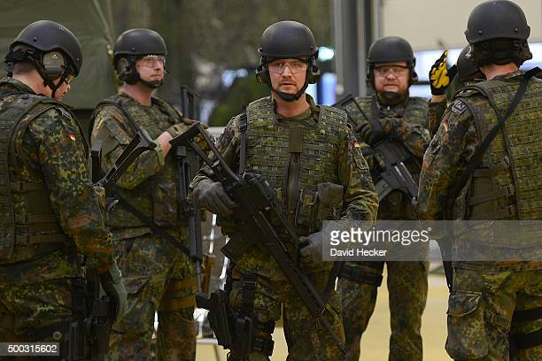 Armed soldiers of the Ostfriesland rapidreaction medical unit of the Bundeswehr the German armed forces trains during a visit from German chancellor...