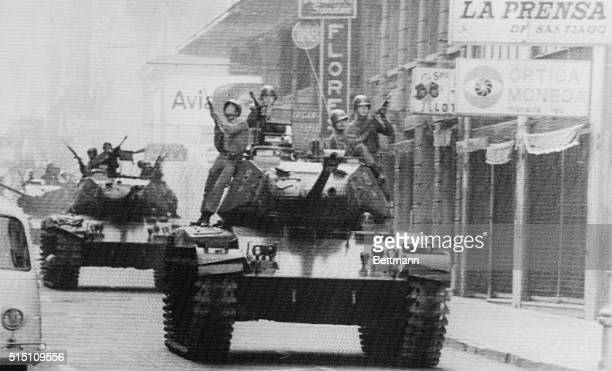 Armed soldiers ride atop tanks in the streets of Santiago here on September 12th as Army Commander General Augusto Pinochet Ugarte is sworn in as...