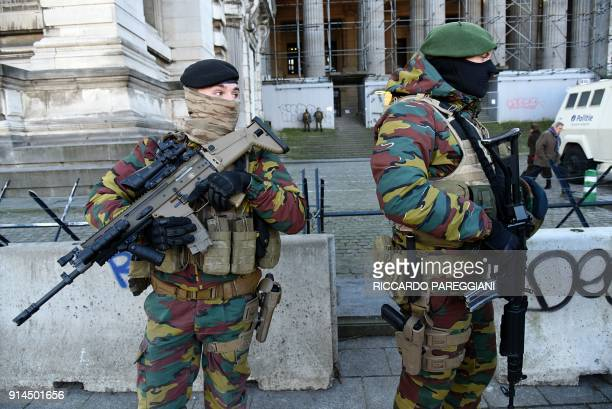 Armed soldiers stand guard in front of Brussels courthouse during the trial of prime suspect in the November 2015 Paris attacks Salah Abdeslam at the...