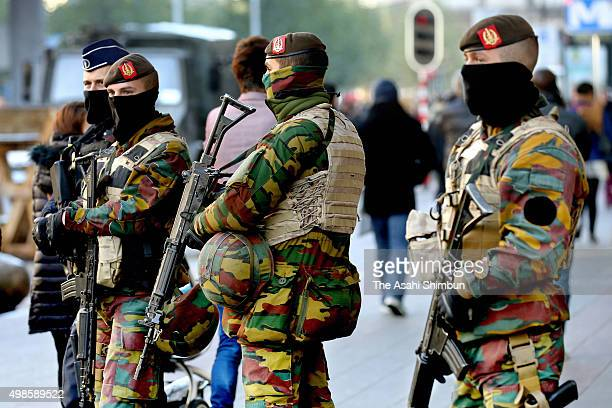 Armed soldiers stand guard on November 23 2015 in Brussels Belgium