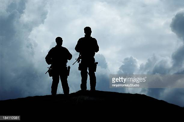 armed soldiers standing on a hilltop - swat stock pictures, royalty-free photos & images