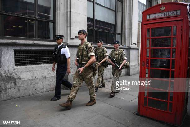 Armed soldiers walk through the streets of London on May 24 2017 in London England 984 military personnel are being deployed around the country as...