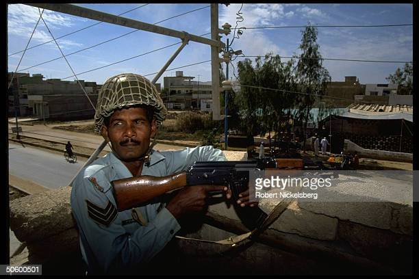 Armed special policeman at post overlooking Sunni Muslim mosque hit in Feb 5 day of sectarian shooting violence during Fri prayer services