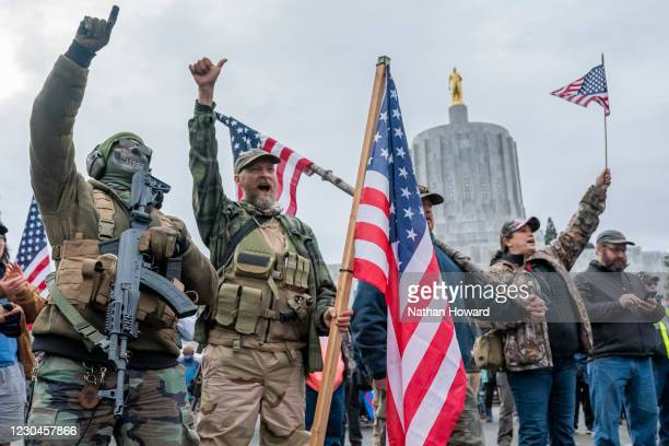Armed supporters of President Trump chant during a protest on January 6, 2021 in Salem, Oregon. Trump supporters gathered at state capitals across...