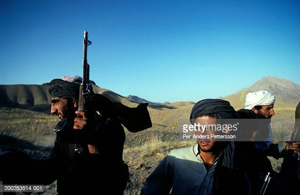 armed taliban soldiers ride on a pick-up truck outside kabul, afghanistan - extremismo imagens e fotografias de stock