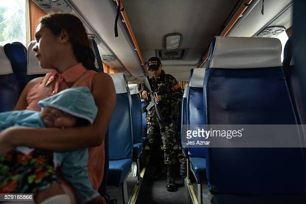 Armed Task Force Davao personel inspecting vehicles at a highway leading to the city on May 8 2016 in Davao City Mindanao Philippines A city of...