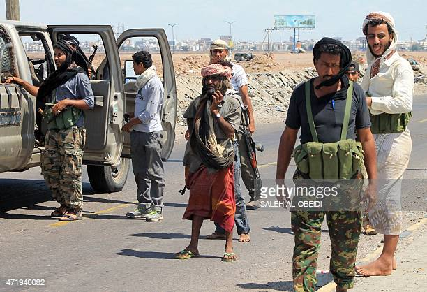Armed tribal supporters of exiled Yemeni President Abedrabbo Mansour Hadi stand near the International airport in the port city of Aden as they...