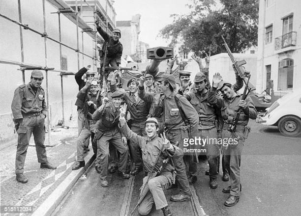 Armed troops relax in street during break in their patrols April 26th General Antonio de Spinola head of the seven man military junta that seized...