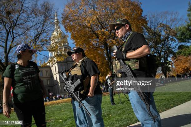 Armed Trump supporters take part in a demonstration at the Michigan State Capitol building on November 07, 2020 in Lansing, Michigan. The pro-Trump...
