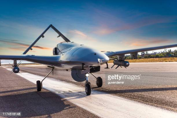 armed unmanned aerial vehicle on runway - army stock pictures, royalty-free photos & images