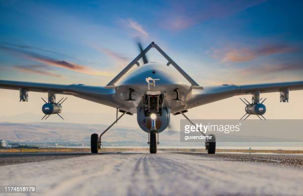 armed unmanned aerial vehicle on runway - drone stock pictures, royalty-free photos & images
