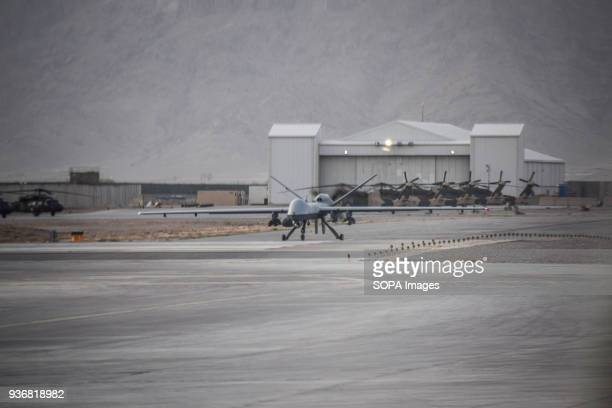 Armed US General Atomics MQ9 Reaper drone waiting for takeoff at Kandahar Air Base Airpower is seen as a decisive advantage of Afghan government...