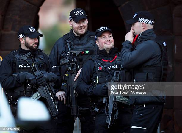 Armed Welsh police outside a memorial service to celebrate the life of the sixth Duke of Westminster at Chester Cathedral Chester