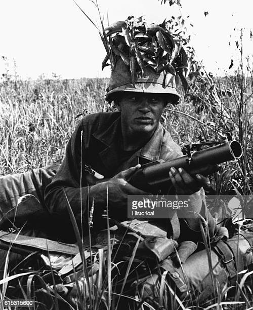 Armed with an M79 Grenade Launcher Pvt Marvin Jordan takes up a defensive position May 5 1965
