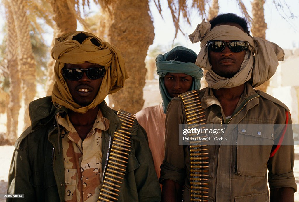 Armed with bandoliers, young soldiers with the Forces Armees Nationales Chadiennes (FANT), or National Army of Chad, guard their post in Faya-Largeau with assault rifles and machine guns. The FANT mission in early 1987 was to reconquer the Borkou-Ennedi-Tibesti Prefecture and recover the territory in northern Chad that had been under Libyan control. For the first time in four years, refugees who fled the Libyan invasion returned to the country.