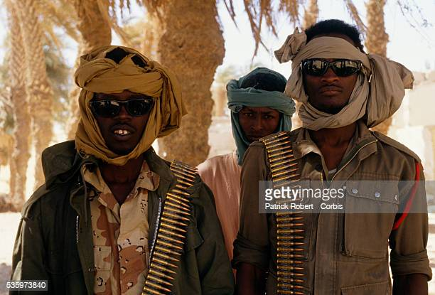 Armed with bandoliers young soldiers with the Forces Armees Nationales Chadiennes or National Army of Chad guard their post in FayaLargeau with...