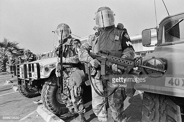 Armed with machine guns and grenade launchers, National Guard soldiers hold a line on Crenshaw blvd. In South Central L.A. Los Angeles has undergone...