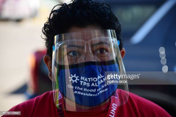 Armed with proBiden leaflets masks visors and good shoes Democratic Party supporter Iris Acosta canvasses the suburbs of Phoenix Arizona October 15...