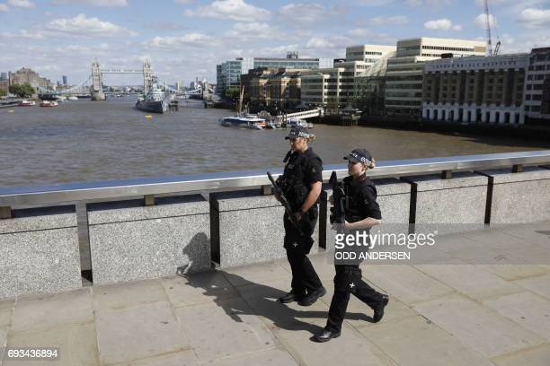 Armed woman police officers patrol on London Bridge in London on June 7 one of the scenes of the June 3 terror attack British police on Wednesday...
