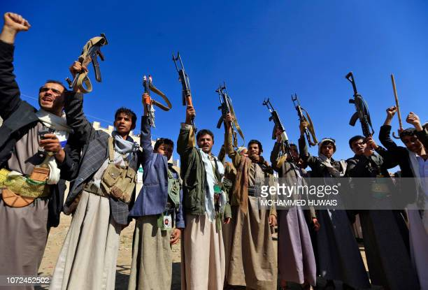 Armed Yemeni men brandish their weapons as they gather in the capital Sanaa to show their support to the Shiite Huthi movement against the Saudi-led...