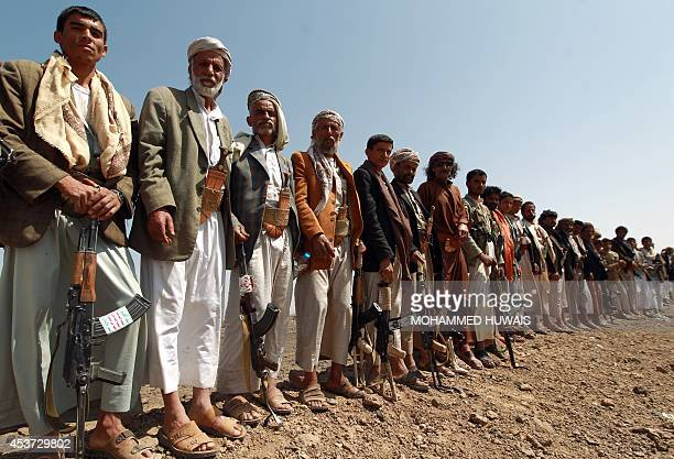 Armed Yemeni men loyal to the Shiite Huthi movement attend a tribal gathering against alQaeda militants in the Bani alHarith area on August 17 2014...