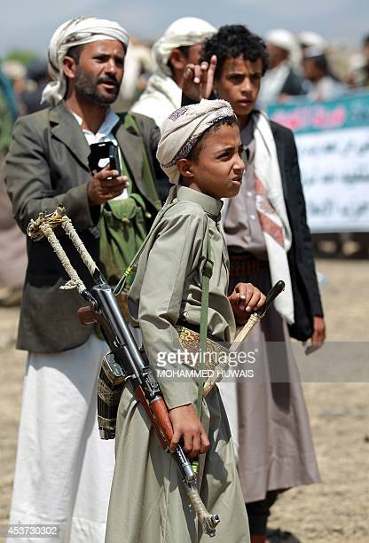 Armed Yemeni men loyal to the Shiite Huthi movement attend a tribal gathering against alQaeda militants in the Bani alHarith area north of Sanaa on...